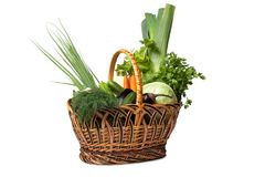 Fresh vegetables in a basket on white. A lot of fresh, different vegetables in the basket Royalty Free Stock Image
