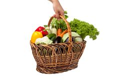 Fresh vegetables in a basket on white. A lot of fresh, different vegetables in the basket Royalty Free Stock Photo