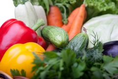 Fresh vegetables in a basket on white. A lot of fresh, different vegetables in the basket Stock Images