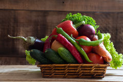 Fresh vegetables in basket on  wooden background Stock Image