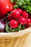 Radish. Fresh vegetables in basket on wooden table Stock Photos
