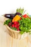 Vegetables. Fresh vegetables in basket on wooden table Royalty Free Stock Image