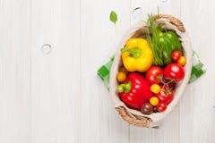 Fresh vegetables basket on wooden table Stock Photos