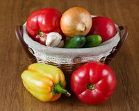 Fresh vegetables in baskets, tomatoes and pepper Stock Photo