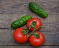 Fresh vegetables from a bed on a wooden table Stock Photo