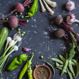 Fresh vegetables - beets, peppers, green beans, onion, garlic, zucchini on dark background. Stock Image