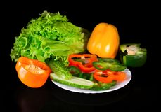 Fresh vegetables on a black background with reflection Stock Image
