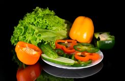 Fresh vegetables on a black background with reflection Royalty Free Stock Photography