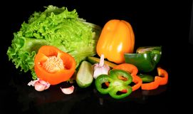 Fresh vegetables on a black background with reflection Royalty Free Stock Images