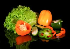Fresh vegetables on a black background with reflection Stock Photos