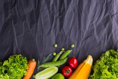 Fresh vegetables on black paper background. With space for text royalty free stock images