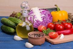 Fresh vegetables on a blue wooden table. Ingredients for cooking royalty free stock photography