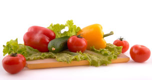Fresh vegetables on board on white background Royalty Free Stock Photos