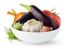 Fresh eggplants in a bowl. Isolated vegetables. Fresh eggplants, tomato, garlic and onion in a bowl isolated on white background royalty free stock photography