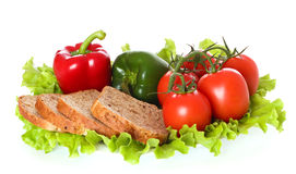 Fresh vegetables. Fresh vegetables and bread on plate, isolated on white background Royalty Free Stock Photos
