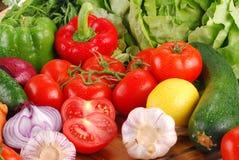 Fresh vegetables on breadboard. Composition with vegetables on breadboard Royalty Free Stock Photos