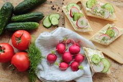 Fresh vegetables for breakfast. Fresh radish, cucumber and tomato for breakfast with bread Stock Photos
