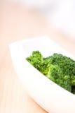 Fresh vegetables- broccoli. Fresh vegetables in white dish Stock Photo