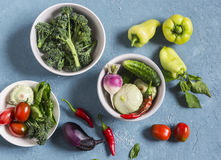 Fresh vegetables - broccoli, peppers, tomatoes, eggplant, squash, turnips on a blue background, top view. Royalty Free Stock Photography