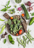 Fresh vegetables - broccoli, zucchini, peppers, beets, green beans and peas, tomatoes on a light background. Royalty Free Stock Images