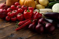 Fresh vegetables on a brown wooden background royalty free stock photography