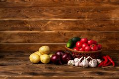 Fresh vegetables on a brown wooden background stock image