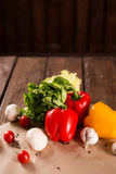Fresh vegetables, bulgarian pepper, lettuce, garlic, mushrooms, cherry tomatoes and spices Stock Image
