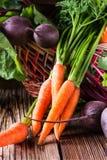 Fresh vegetables carrot, beetroot on  wooden background. Harvest still life Stock Photo