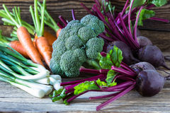 Fresh vegetables carrots, beetroots, broccoli, green onion on  w Royalty Free Stock Photo