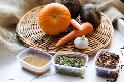 Fresh vegetables. Carrots, beets, pumpkin, onion, spice on the wicker tray Royalty Free Stock Photography