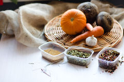 Fresh vegetables. Carrots, beets, pumpkin, onion, spice on the wicker tray Royalty Free Stock Image