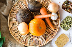 Fresh vegetables. Carrots, beets, pumpkin, onion, spice on the wicker tray Stock Photography