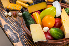 Fresh Vegetables and Cheese in Bowl on Wood Table Stock Photography