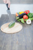 Fresh vegetables on chopping board and dark table. A composition of vegetables Royalty Free Stock Photo