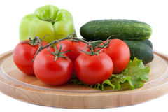 Fresh vegetables on a chopping board Royalty Free Stock Photos