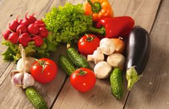 Fresh vegetables on a clean wooden table Royalty Free Stock Images