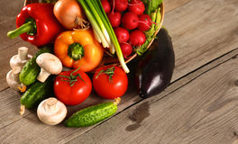 Fresh vegetables on a clean wooden table Stock Photography