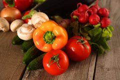 Fresh vegetables on a clean wooden table Stock Photo