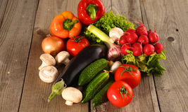 Fresh vegetables on a clean wooden table Royalty Free Stock Photography