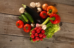 Fresh vegetables on a clean wooden table Royalty Free Stock Photos
