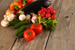 Fresh vegetables on a clean wooden table Royalty Free Stock Image