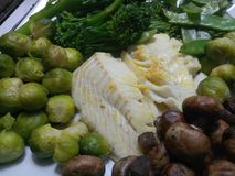 Close up of a fried cod meal. With fresh vegetables Royalty Free Stock Photo