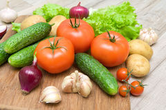 Fresh vegetables closeup on wooden background Royalty Free Stock Photos