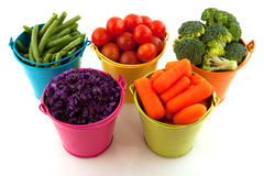 Fresh vegetables in colorful buckets Royalty Free Stock Images