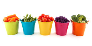 Fresh vegetables in colorful buckets stock image