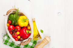 Fresh vegetables and condiments on wooden table Stock Images