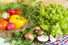 Fresh vegetables covered with water drops in basket. Royalty Free Stock Photo
