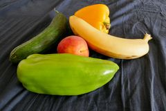 Fresh vegetables cucumber peppers and banana Stock Photo