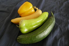 Fresh vegetables cucumber peppers and banana Stock Photography