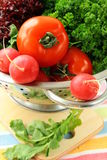 Fresh vegetables, cucumber, radish, tomato. And lettuce in a colander Stock Images